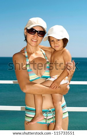 Happy family resting at the resort together - stock photo