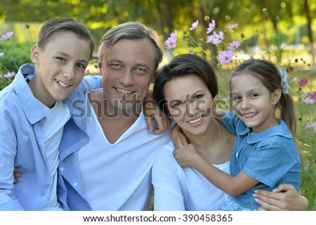 Happy Family resting in  summer park - stock photo