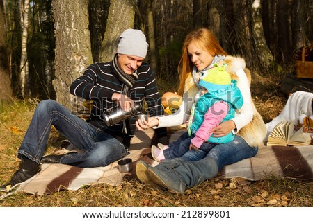 Happy family resting on nature autumn - stock photo
