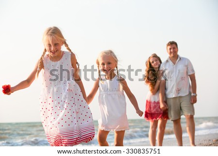 Happy family resting on the summer beach - stock photo