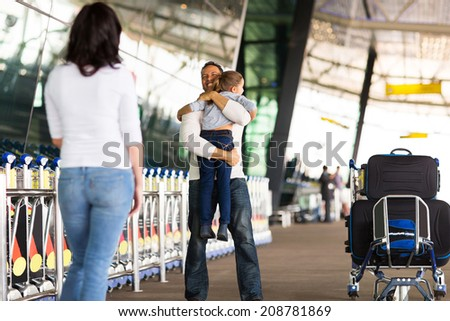 happy family reunion at airport - stock photo