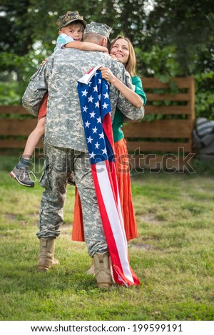 Happy family reunited, father in military uniform returns home . Us happy family portrait. focus on man - stock photo