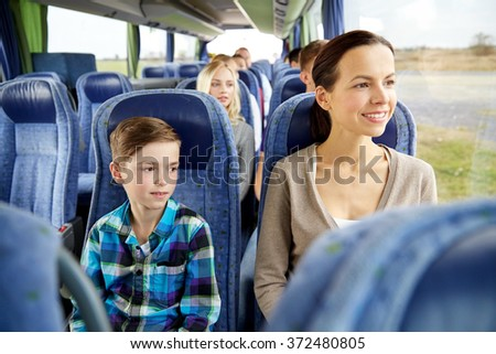happy family riding in travel bus - stock photo