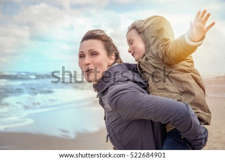 happy family running along the cold coast
