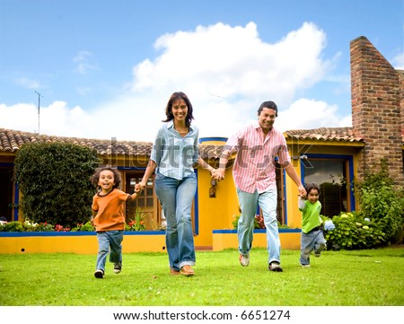 happy family running and having fun outdoors smiling and enjoying - stock photo