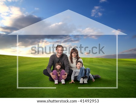 happy family seated on grass field surrounded by home drawing - stock photo