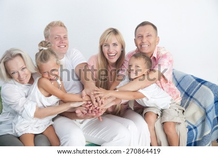 Happy family show love and unity with gesture holding hands together. - stock photo