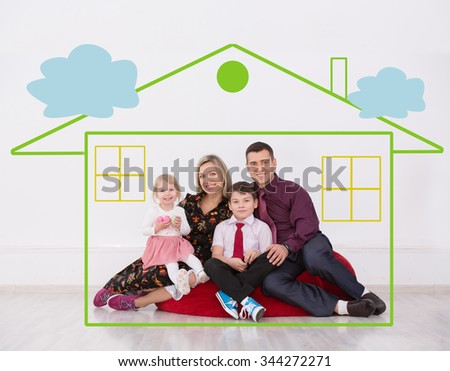happy family sitting in a painted house