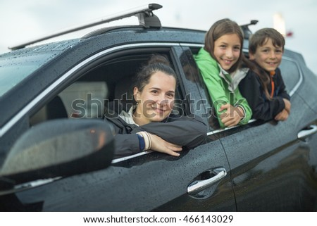 happy family sitting in the car