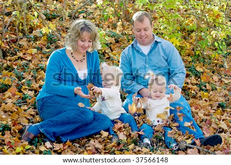 Happy Family Sitting in the Yard - stock photo