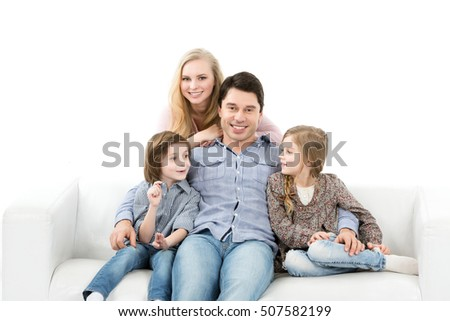 Happy family sitting together. Isolated.