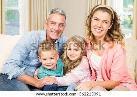 Happy family sitting together on a couch