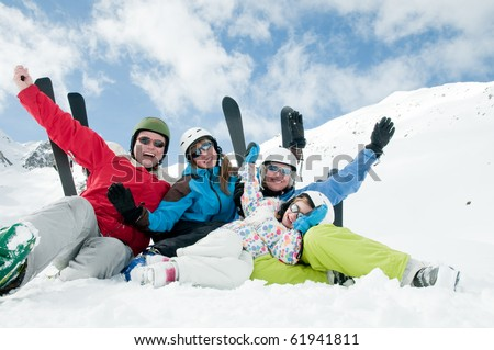 Happy family ski team - stock photo