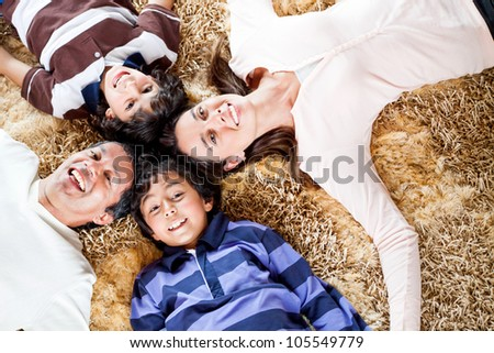Happy family smiling and having fun at home - stock photo