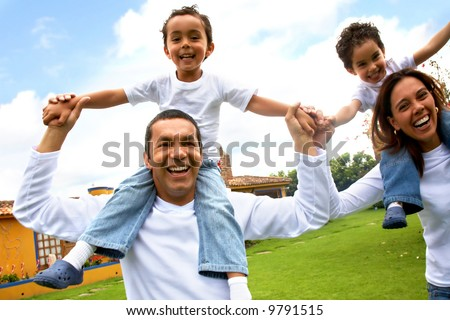 happy family smiling and having fun outdoors