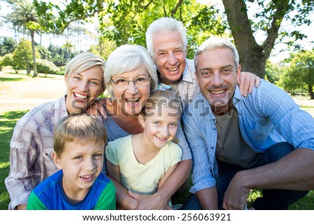 Happy family smiling to the camera on a sunny day