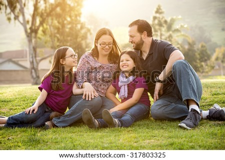 Happy family spending time in the park - stock photo
