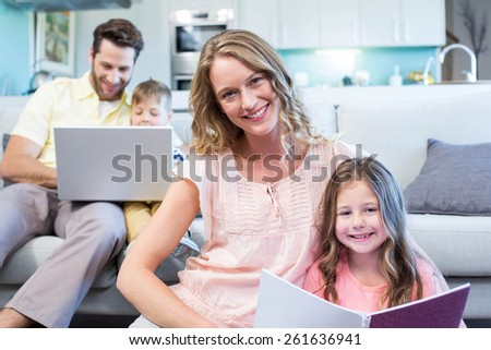 Happy family spending time together at home in the living room - stock photo