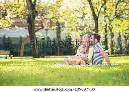 Happy family spending time together in the park - stock photo