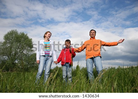 happy family stand in grass