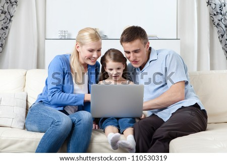 Happy family surf on the internet - stock photo