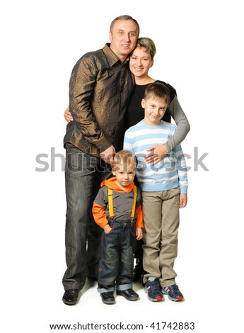 Happy family. The daddy, mum, two sons. It is isolated on a white background.