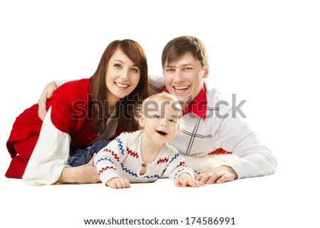 happy family three persons, smiling father mother and laughing baby lying over white background - stock photo