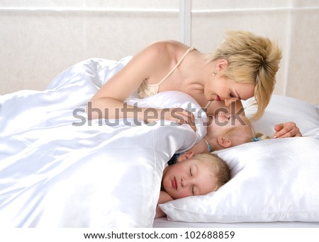 happy family to bed in the bedroom - stock photo