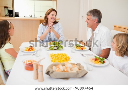 Happy family together at the dinner table - stock photo