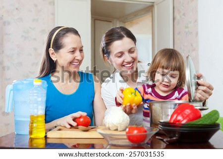 Happy family together cooking lunch with vegetables