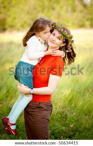 Happy family together in summer park - stock photo