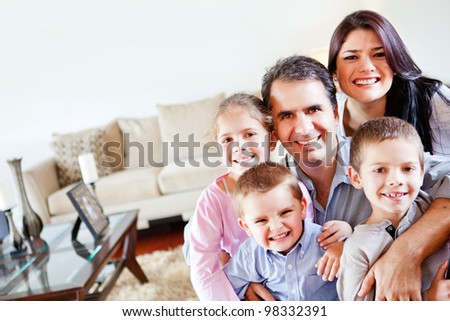 Happy family together in the living room - stock photo