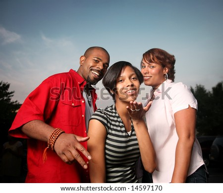 Happy family together outdoors at twilight - stock photo
