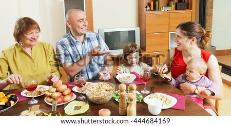 happy family together over dining table at home interior - stock photo