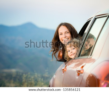 Happy family travel by car in the mountains. Summer vacation concept - stock photo