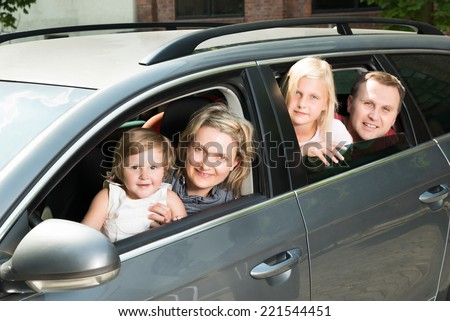 Happy Family Traveling By Car. Outdoors Shot