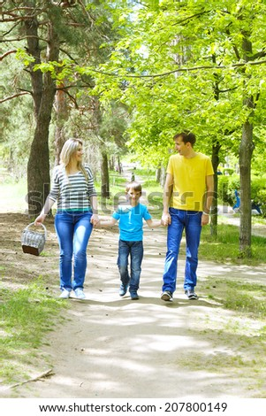 Happy family, walk in the park - stock photo