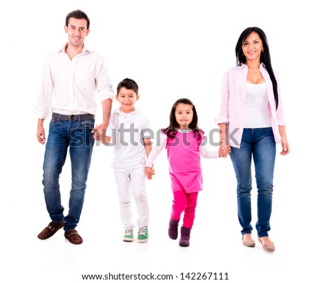 Happy family walking and holding hands - isolated over white - stock photo