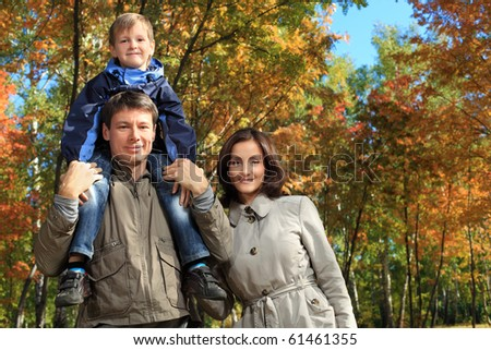 Happy family walking at the autumn park. - stock photo