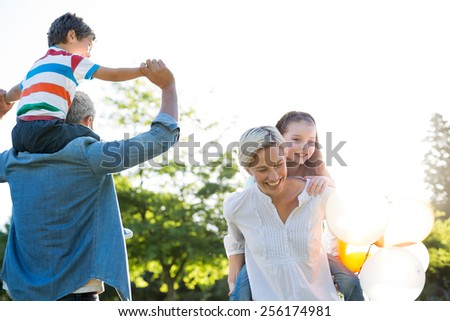 Happy family walking at the park - stock photo