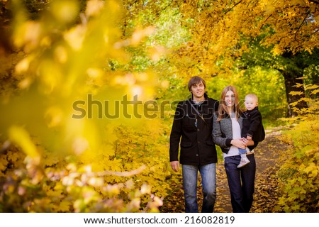 happy family walking in the autumn park - stock photo