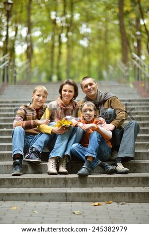 Happy family walking in the park on weekends - stock photo