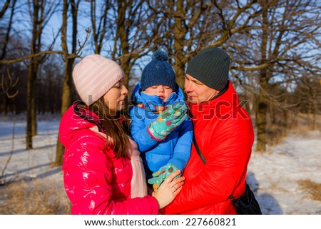 happy family walking in winter forest. Christmas - stock photo