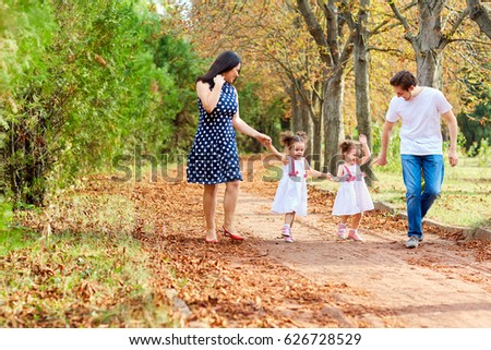 Happy family walks play in the park.