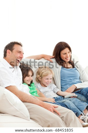 Happy family watching a movie together at home - stock photo