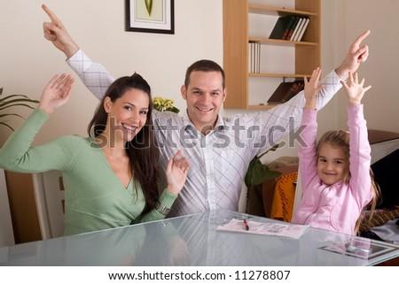 happy family waving - stock photo