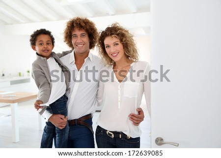 Happy family welcoming people in new home - stock photo