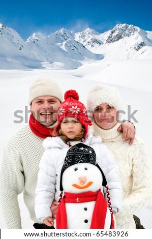 Happy family winter vacation - stock photo