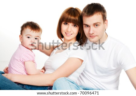 happy family with a baby on a white background