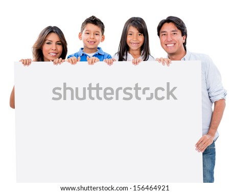 Happy family with a banner ad - isolated over white background  - stock photo